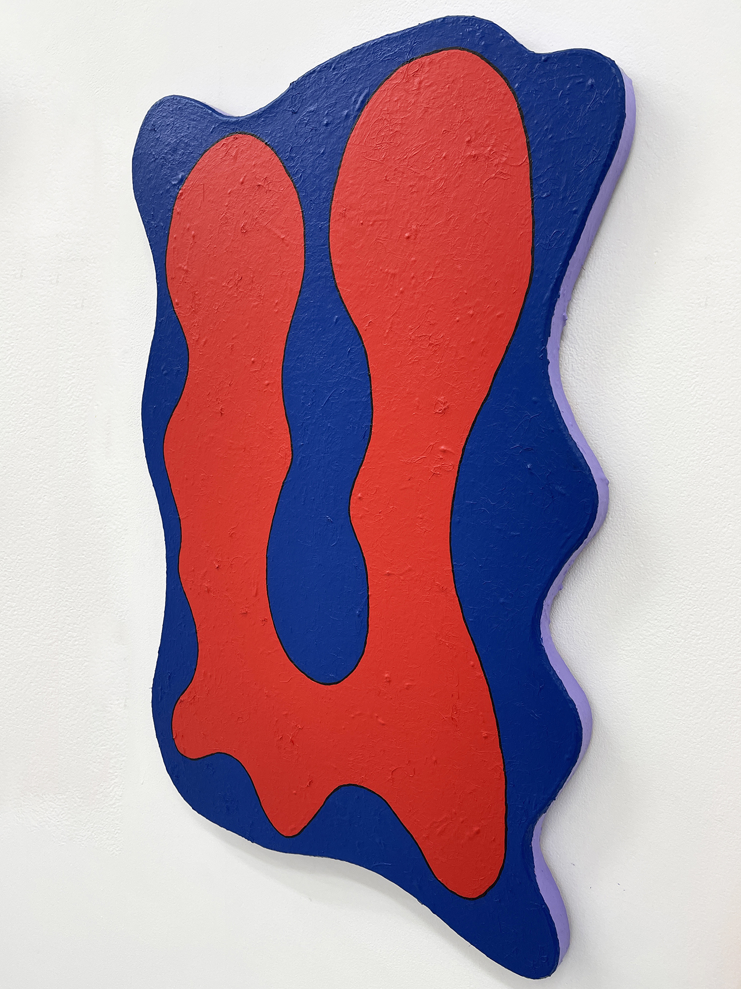 A red and blue painting with shaped canvas